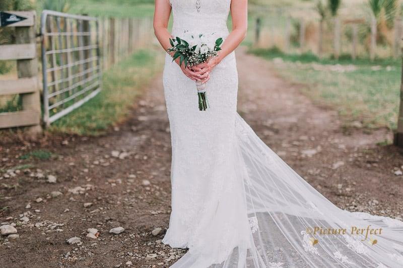 Look at the dress, the flower, just a perfect blend of elegance and beauty...#lace #vintage #wedding #weddingphotograph #newzealandwedding #weddingphotographer #weddingdress #vintagewedding #weddingdetails #vsco #vscocam #nzwedding #kiwibride #nzphotography #picoftheday #visualoflife #justgoshoot #2017wedding #weddingtrends #bridalgown #inspiration #bride #instagood #weddinginspo